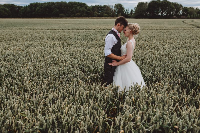 bassmead-manor-barn-field-newlywed